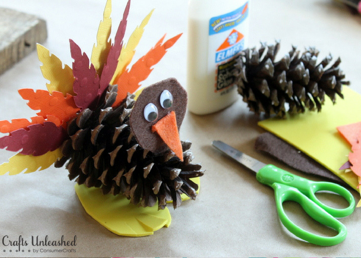 While Thanksgiving dinner is in the oven, send the kids out into the backyard to collect pinecones for this cute turkey craft!