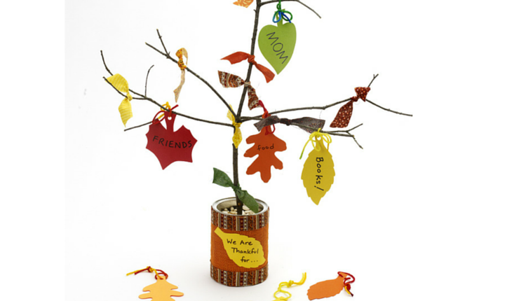 "This homemade ""Thanksgiving tree"" engages kids to think about the holiday's meaning, plus it makes a beautiful centerpiece on your dinner table."